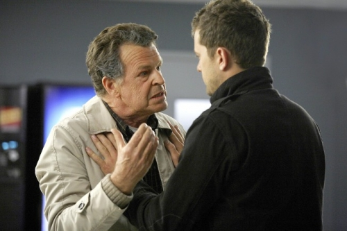 FRINGE: Peter (Joshua Jackson, R) tries to calm Walter (John Noble, L) after a terrible accident in the FRINGE Season Two premiere episode